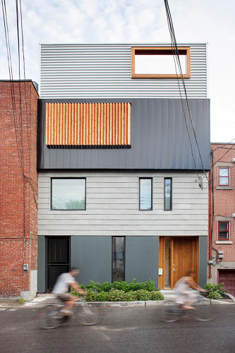 <p>Designed by Montreal firm NatureHumaine, the house sits on a tiny lot that forced the architects to ponder a more vertical orientation.</p>