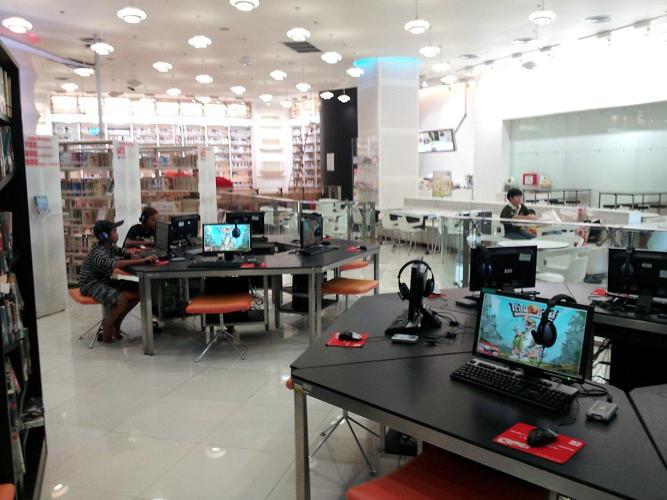 <p>A high-tech library in Thailand offers computer pods and print reference material.</p>