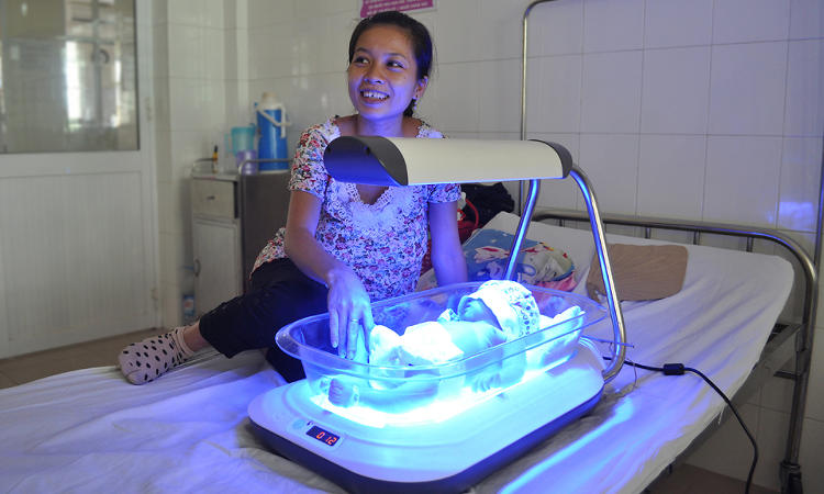 <p>Nguyen Thu Tuyet talks with the DtM team as her son, To Trai, receives treatment from Firefly at Da Nang Hospital for Women &amp; Children in Vietnam.</p>