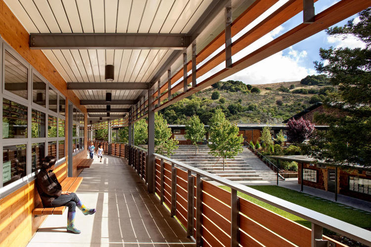 <p>The 34,000-square-foot-project features classrooms, art studios, student service offices, a library and technology center, a courtyard, a playground, and a creek restoration.</p>