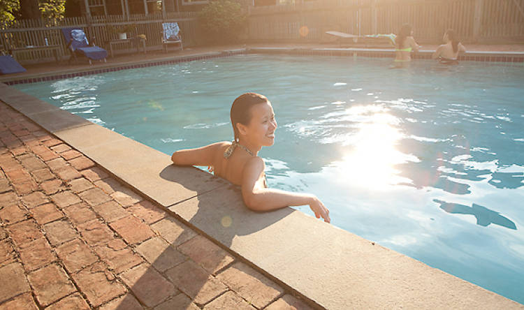 As the sun set, however, some took a break to chat and decompress in the pool. Here Jamie Lee, a business operations manager for JumpThru, catches some well-earned rays.