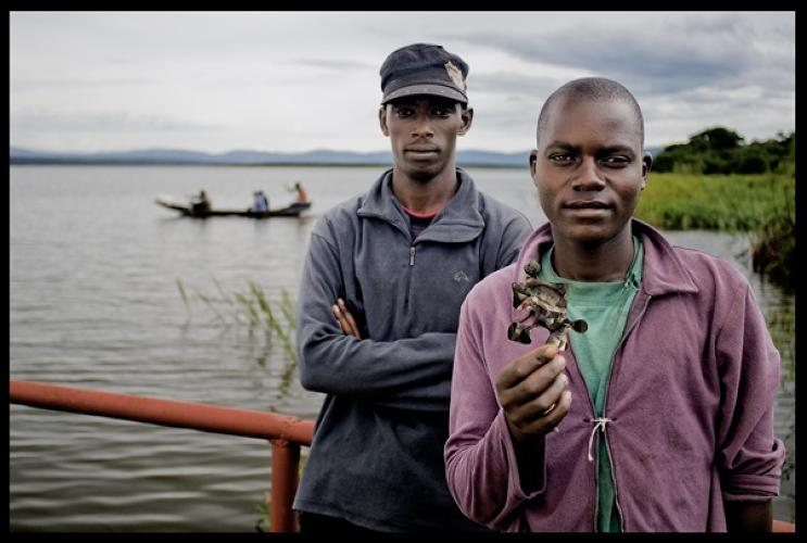 Nepo and Diedone Bivugire derive their income fishing tilapia at Lake Ihema, in Akagera National Park. Among papyrus and hippos, wooden traditional canoes move them over the shrinking shoals of fishes.