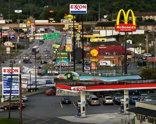 A puzzle of neon lights and highway signs in Breezewood, Pennsylvania