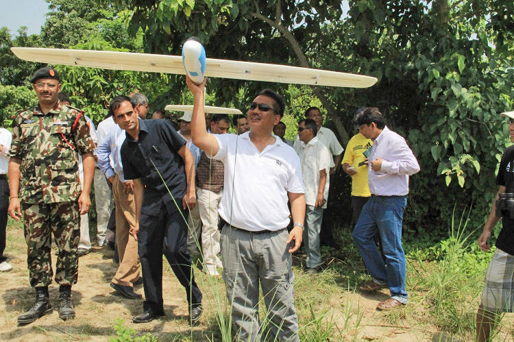 <p>Drone functionality being explained to Nepalese team</p>