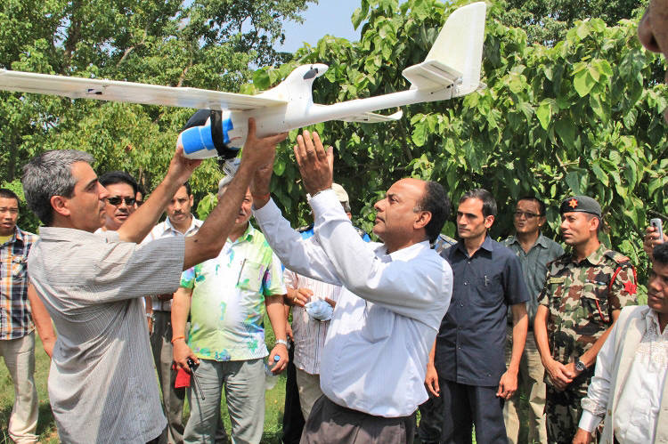 <p>WWF's Nepal staff tests out the drone</p>
