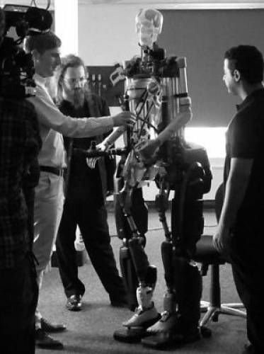 <p>A team from Shadow Robot Company helps get Rex on its feet.</p>
