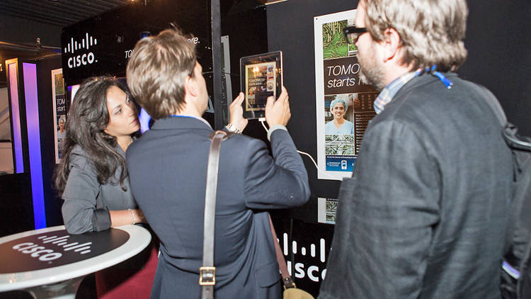 <p>Guests check out Cisco's augmented reality booth.</p>