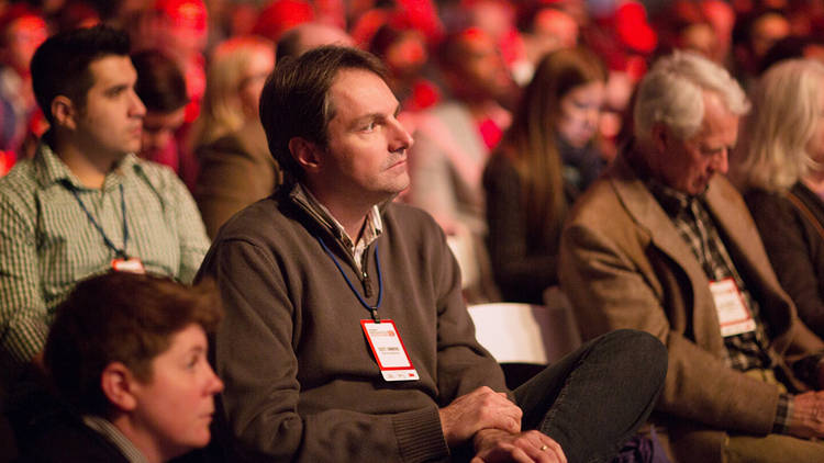 <p>An audience member participates in one of the days Q&amp;A sessions.</p>