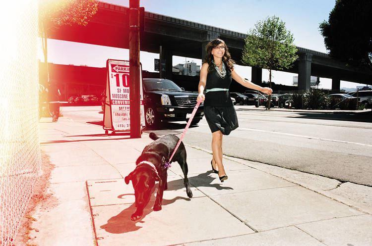 <p>Busque and her new dog; its predecessor inspired TaskRabbit.</p>