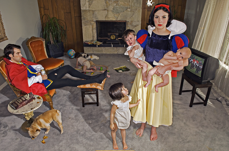 <p>Dina Goldstein's photo series &quot;Fallen Princesses&quot; shows familiar princesses in unfamiliar, bleak contexts.</p>