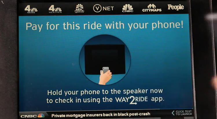 <p>Once you're in a cab and on your way, a Way2Ride prompt instructs to hold your phone up to the in-cab TV screen to &quot;check in&quot; to the cab.</p>