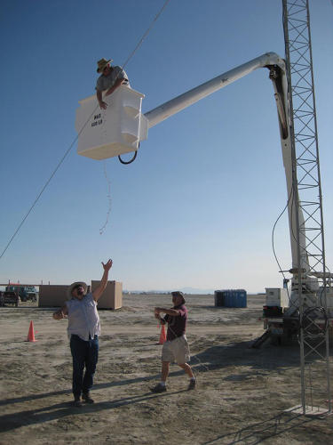 <p>Peterson spends a total of three weeks each year on the playa. The first week of August, he and the team are &quot;all hands on deck,&quot; putting up towers, running cables, and generally getting as much limited infrastructure up as possible.</p>