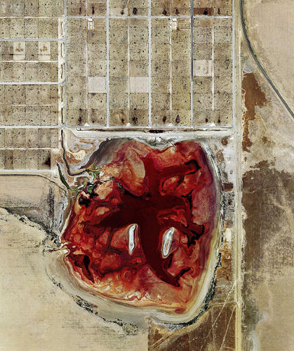 <p>Henner, who was researching satellite photographs of oil fields when he discovered the images, didn't even realize what they depicted at first.</p>  <p>A waste lagoon at Coronado Feeders, Dalhart, Texas (2013).</p>