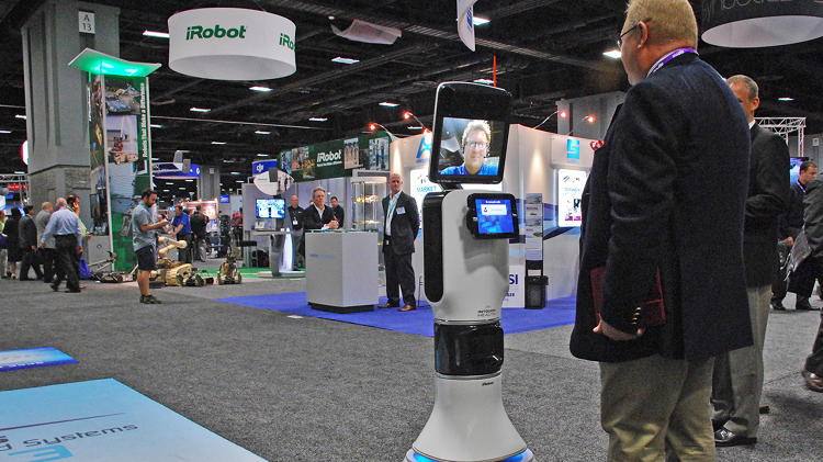 <p>InTouch RP-VITA, a remote presence robot, allows a doctor to visit patients in a hospital, even if he or she is elsewhere. The doctor's face appears on the screen and he or she can talk to patients and colleagues via uplink.</p>