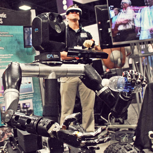 <p>Robo Sally was developed by the Applied Physics Laboratory at Johns Hopkins and is part humanoid and part rover. It kind of looks like someone got their instruction manuals mixed up, but you can control it with gloves, arm-bands, and a virtual reality helmet.</p>