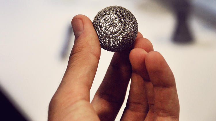 <p>GE showed off a 3-D printer than can print titanium, including this ball.</p>