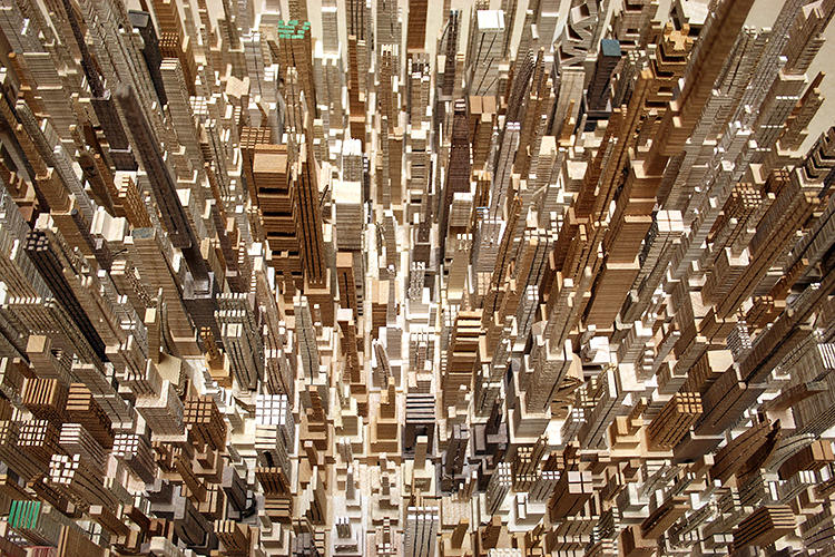 <p>He uses a bandsaw for his work, taking pleasure from the way the marks of the saw blade mimic the real-world textures and patterns you would find in a real city environment.</p>