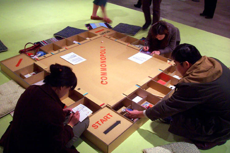 <p>Commonopoly demands that players brainstorm alternative economic systems through activities placed around the board.</p>