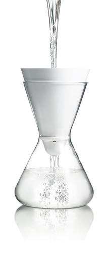 "<p>Thus, the hourglass shape: ""We inverted the conical filter funnel at the top to emphasize the transformational process and opposite nature of unpure and pure water.""</p>"