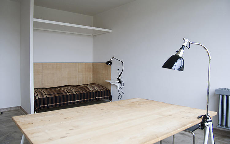 <p>They lived and slept in the Prellerhaus, or Studio Building, designed by the architect and Bauhaus director Walter Gropius.</p>