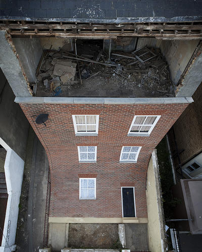 <p>UK artist Alex Chinneck's installation, &quot;From the Knees of My Nose to the Belly of My Toes,&quot; re-creates the slack-jawed physics of cartoons using real-life architecture.</p>