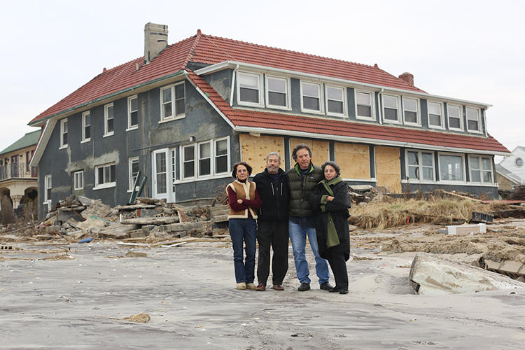 <p>A family in the far Rockaways after Hurricane Sandy. (AP Photo/Humans of New York, Brandon Stanton)</p>