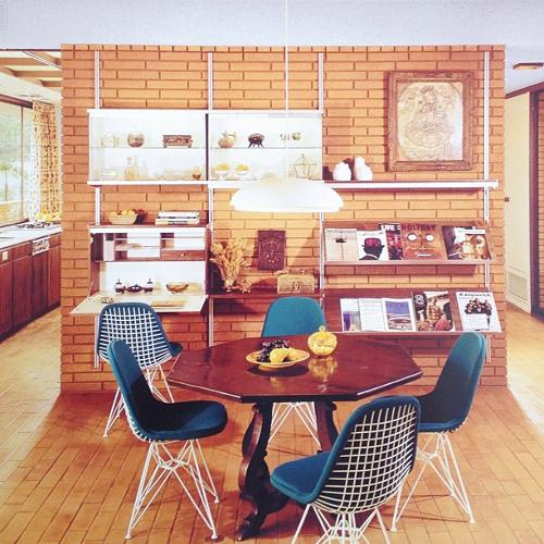 <p>In the Case Study program, the now-defunct <em>Arts &amp; Architecture</em> magazine commissioned prominent architects to design cheap model homes. This shot of Case Study House 28 shows upholstered Eames wire frame chairs.</p>