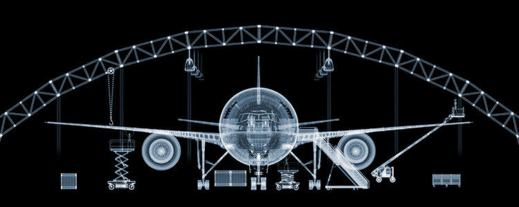 <p>British photographer Nick Veasey's new book, <em>X-Ray: See Through the World Around You</em>, is a collection of 205 radioactively beautiful photographs of everyday objects, nature, and the human body in action. Here, a Boeing 777.</p>