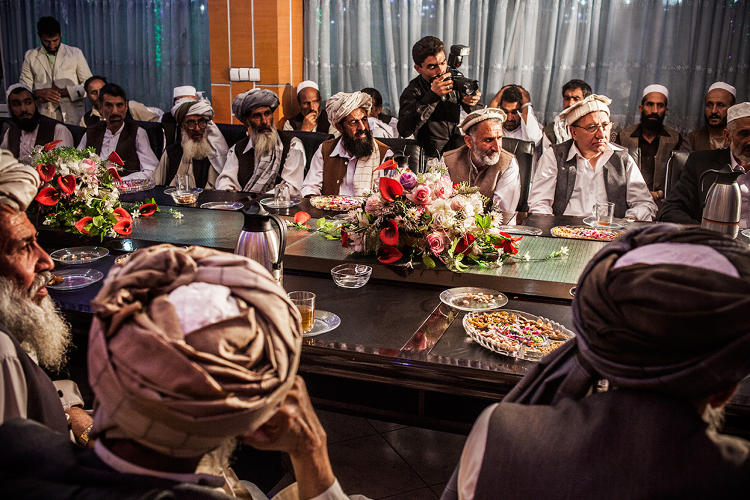 <p>Dunya Wedding Hall, Kabul<br /> Male guests witness the signing of the documents making the wedding (or nikah) official.</p>