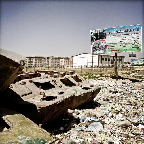 <p>The hulks of destroyed Soviet-era military vehicles sit in front of half-built apartment buildings in Kabul.</p>