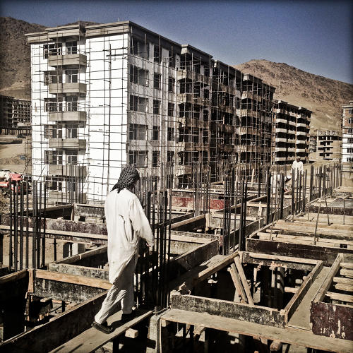 <p>At Khaaja Rawaash Township, on the outskirts of Kabul near the airport, some of the largest housing construction in the country is under way, with some 2,000 workers constructing 72 buildings. The apartments inside, priced from $28,000 to 87,000--well below market rates--are exclusively for Afghan government officials and employees and were almost entirely sold out, even before the project was completed.</p>