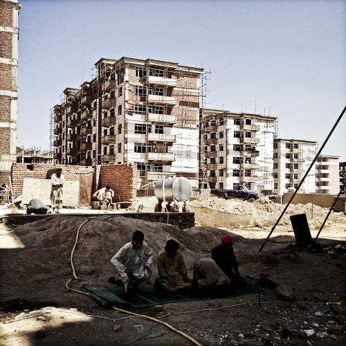 <p>Construction workers break for prayers.</p>