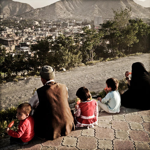 <p>A family looks out over Kabul.</p>