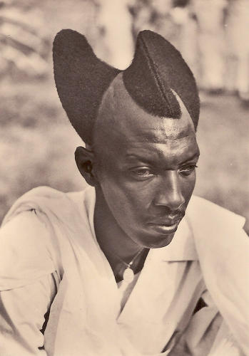 <p>Tutsi man, 1923. &quot;The Mohawk has often been worn to impress an adversary, to galvanize warriors in battle or to mark social status,&quot; writes Philippon. Ancient artifacts reveal that some African tribes have always styled their hair into crests.</p>