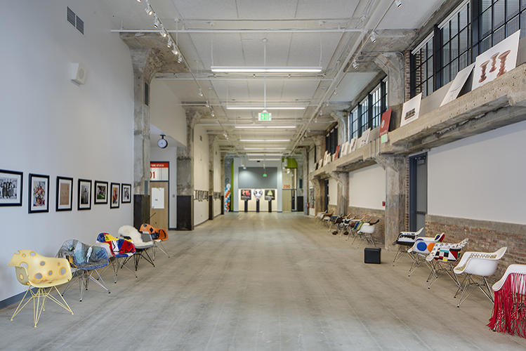 <p>Many spaces boast 17 foot tall ceilings and hallways double as galleries for contemporary design.</p>