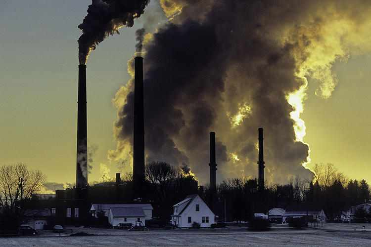 <p>A plant powered by coal in Conesville, Ohio, looms large over the small town. The burning of carbon is warming our atmosphere and changing our climate at a rapid rate.</p>