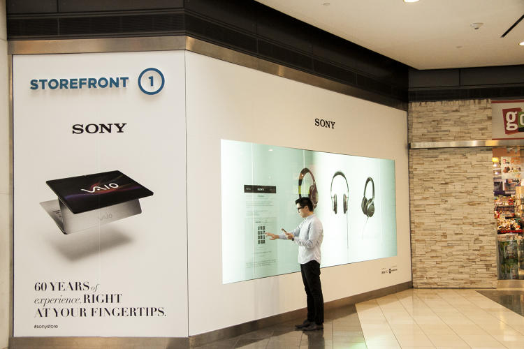<p>Customers purchase Sony items via a giant touchscreen.</p>