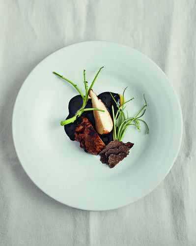 <p>Slowly sauteed celeriac and truffle sauce. Ingredients include Gotland truffles and squid ink.</p>