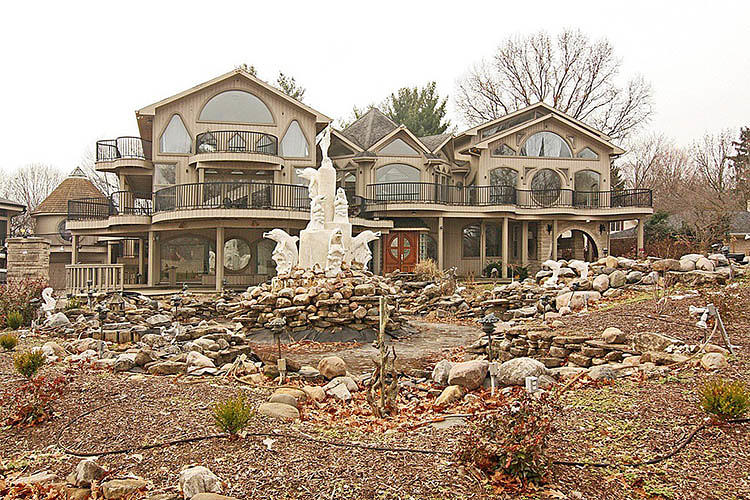 <p>Designers with delicate sensibilities, look away. This may be the most hideous McMansion in America.</p>