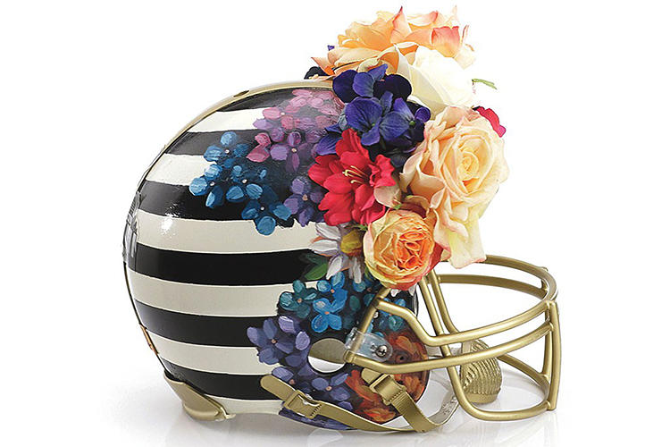 <p>On the occasion of the 48th Super Bowl, which is being held for the first time in New York, the Council of Fashion Designers of America (CFDA) set out to give helmets a runway-worthy makeover. Here, Nicole Miller's floral design.</p>