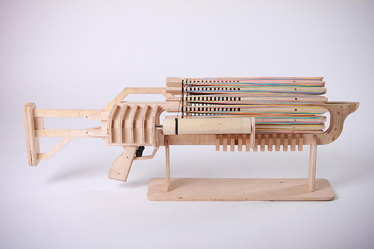<p>CNC milled out of wood, the Rubber Band Machine Gun is based off of gatling gun principles.</p>