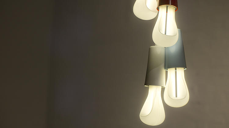 <p>The new Plumen, above, looks more like a traditional lightbulb, whereas the Plumen 001 used twisting loops of glass to create a novel, sculptural look. But while beautiful to look at, the original Plumen was too bright for certain settings--like living rooms, or restaurants.</p>