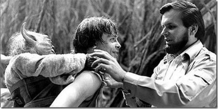 <p>Associate Producer Gary Kurtz helps Mark Hamill with his Yoda backpack.</p>
