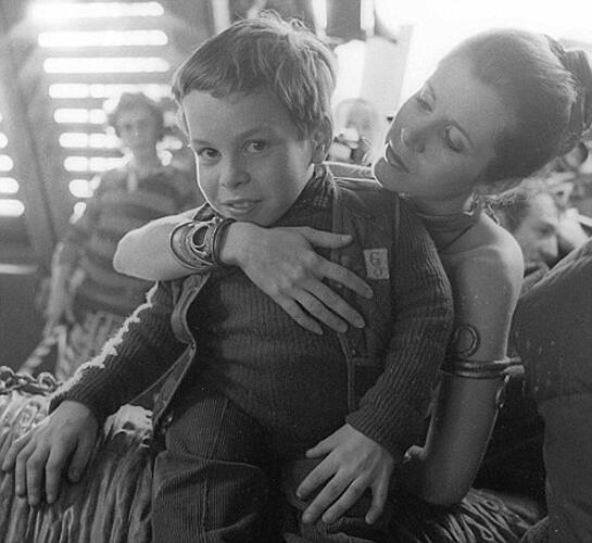 <p>Carrie Fisher with an 11-year-old Warwick Davis on her lap.</p>
