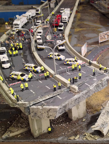 <p>In the final version, cars are overturned, stores are looted, and concrete roads are cracking apart.</p>