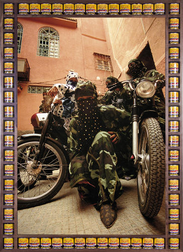<p>The artist built the frames for his biker photographs from everyday objects, like soda cans, boxes of chicken stock, and Legos printed with Arabic letters.</p>