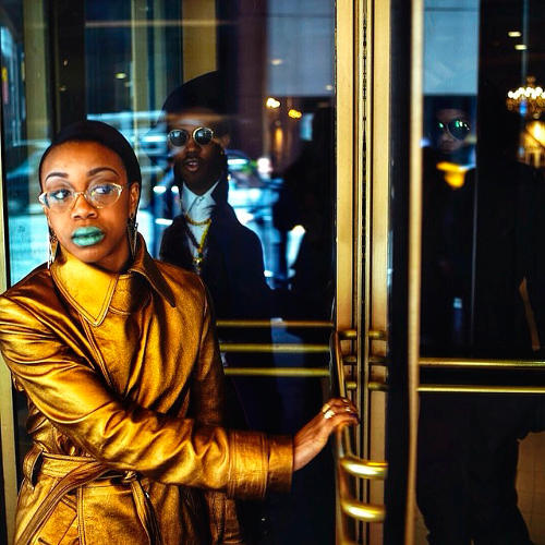 <p>Revolving door. Brianna is followed by Timbo and Donnell as they head out to hail a taxi on their way to Lincoln Center.</p>