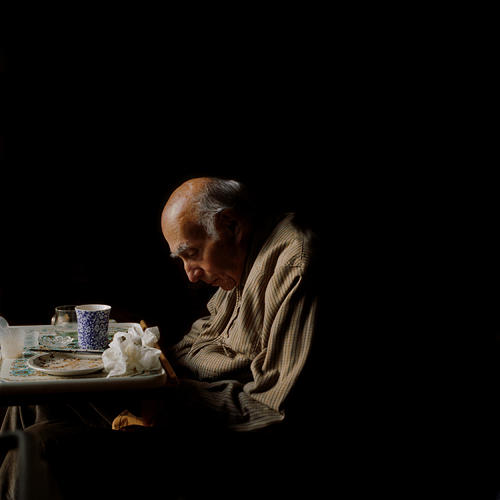 <p>Goldblatt turns their everyday activities into visual poetry—this shot of her father slumped at the breakfast table is lit as dramatically as a Caravaggio.</p>