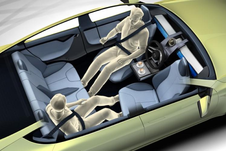 <p>Kicking back in a self-driving commute.</p>