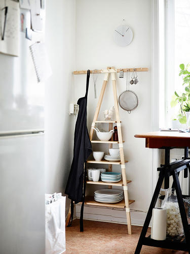 <p>Because this stacked shelving rack has a horizontal component, it could easily hold an entire kitchen's worth of cooking utensils.</p>
